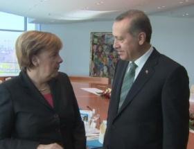 Merkel, Erdoğanın çekiciliğine karşı şerbetli