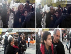 Kızını eylemcilerin arasından çekip aldı